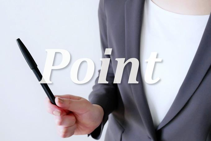 ペンを持つ女性。Pointの文字